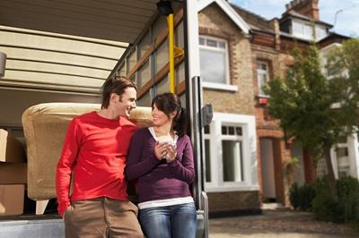 couple moving house removal van