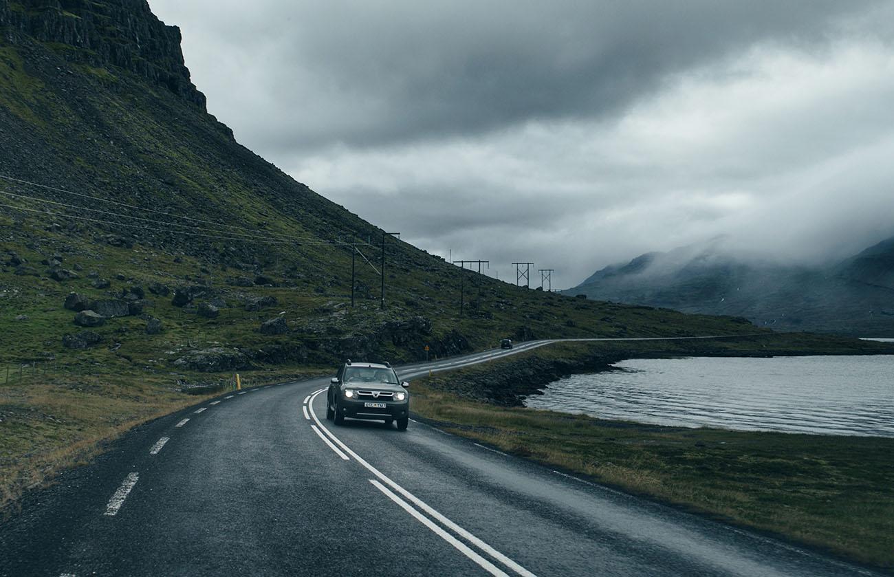 Black Dacia Sandero on mountain road
