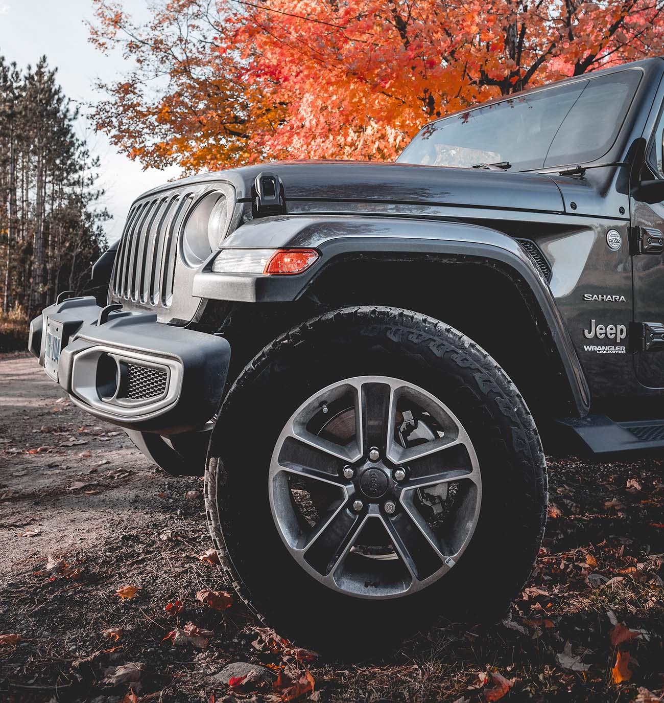 Jeep in autumn landscape