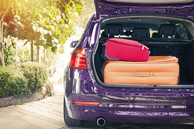 Purple car with luggage in the boot
