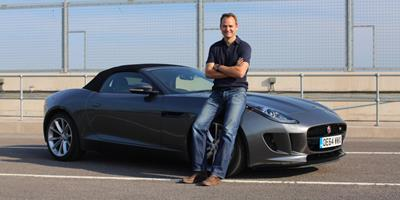 Ben Collins aka The Stig standing in front of a car