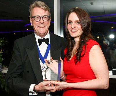 Claire Smith receiving CII award plaque