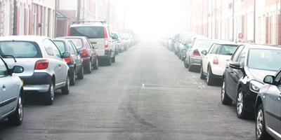 street lined with parked cars on both sides