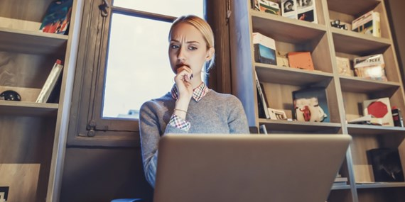 Woman looking at a website suspiciously