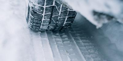 Car tyre rolling over snow