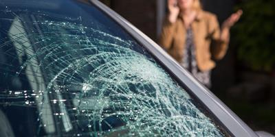Car with a smashed front windscreen