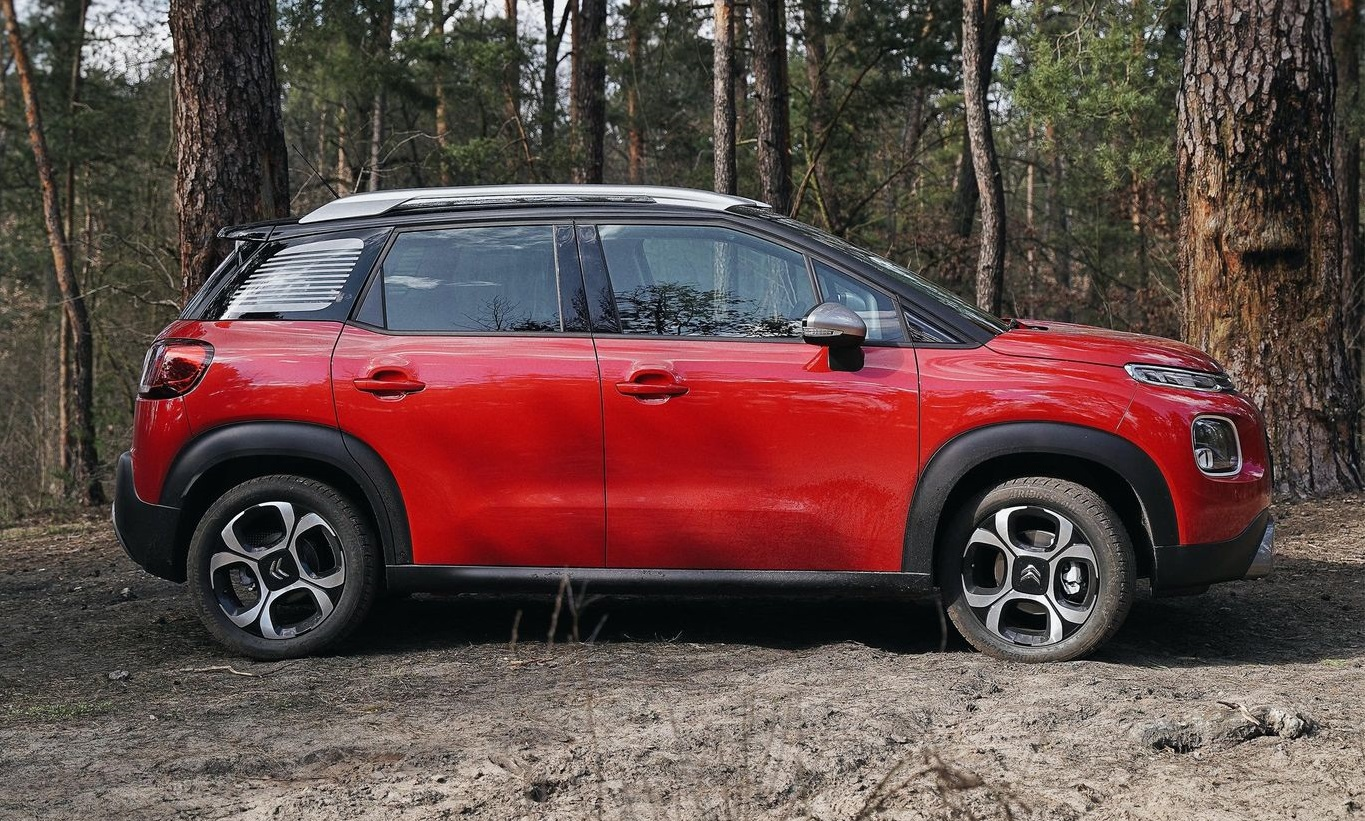 Red Citroen parked in woods