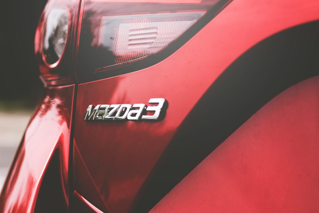 Red Mazda 3 car badge