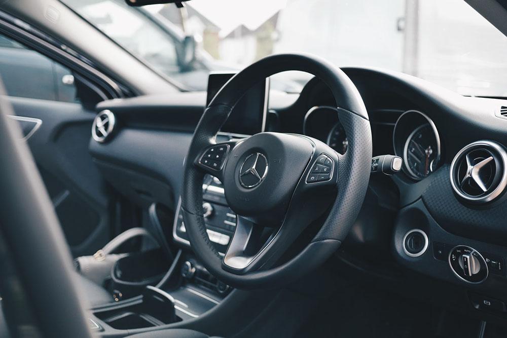 Mercedes car interior with steering wheel
