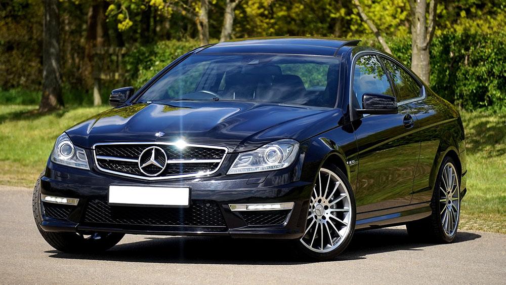 Black Mercedes parked on road