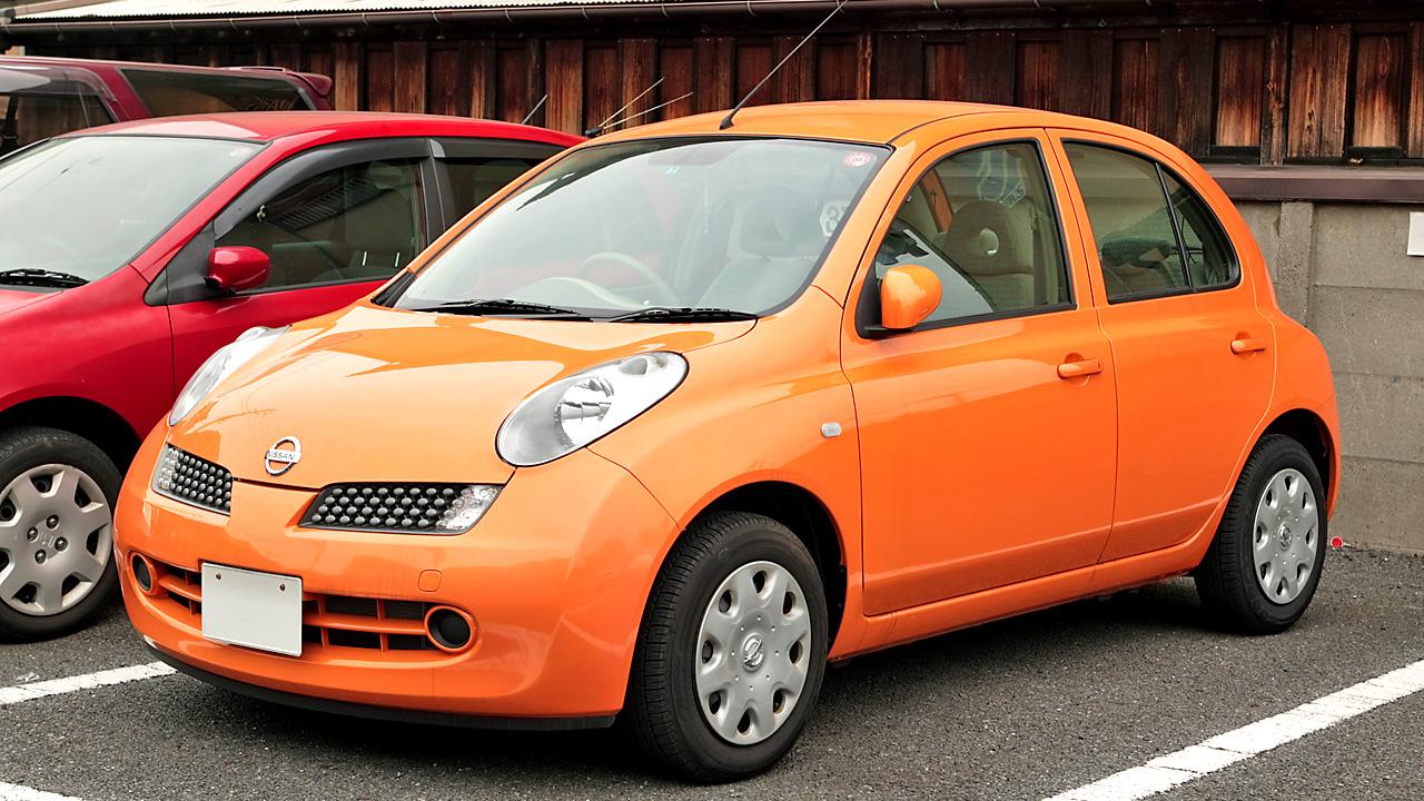 Orange nissan micra car
