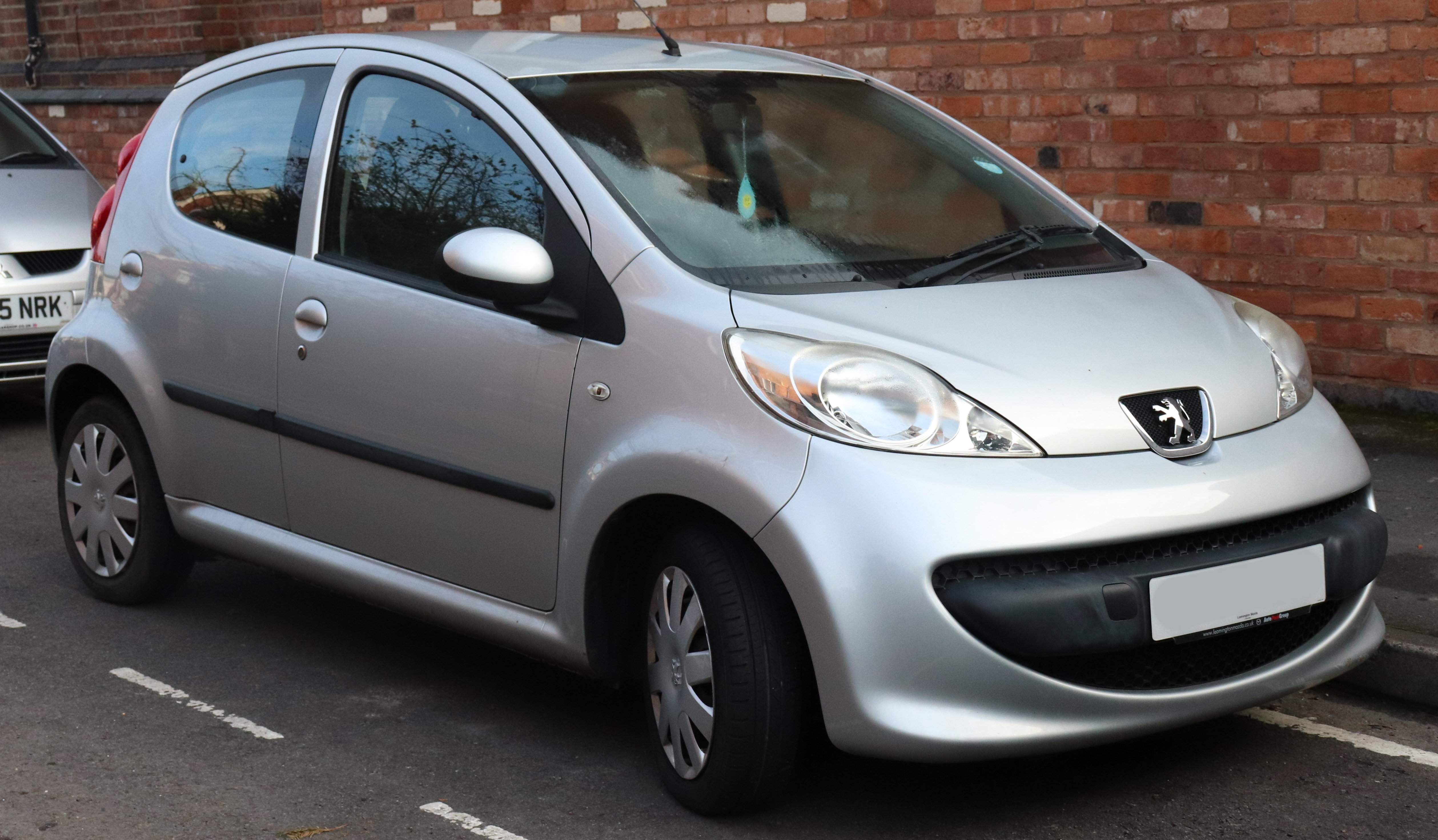 Parked silver Peugeot 108
