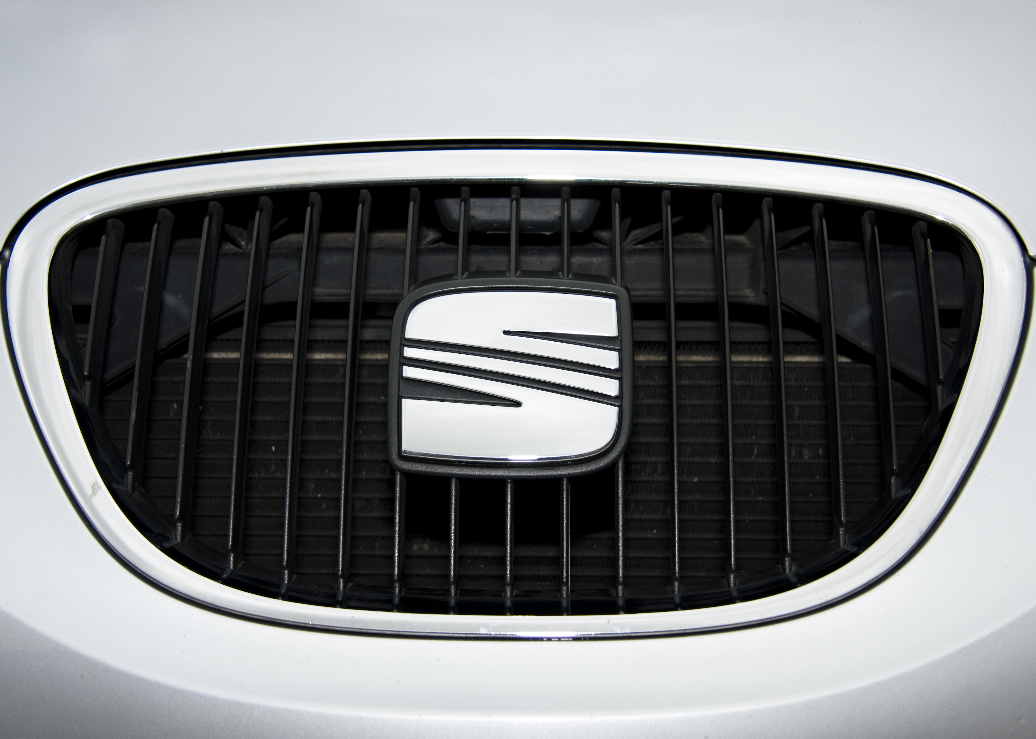 Silver SEAT Leon car badge