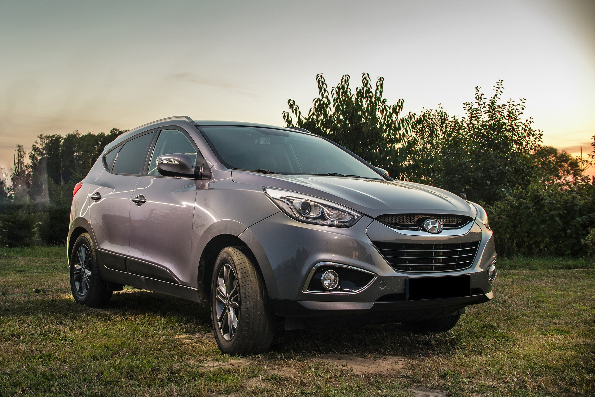 Hyundai SUV parked in field