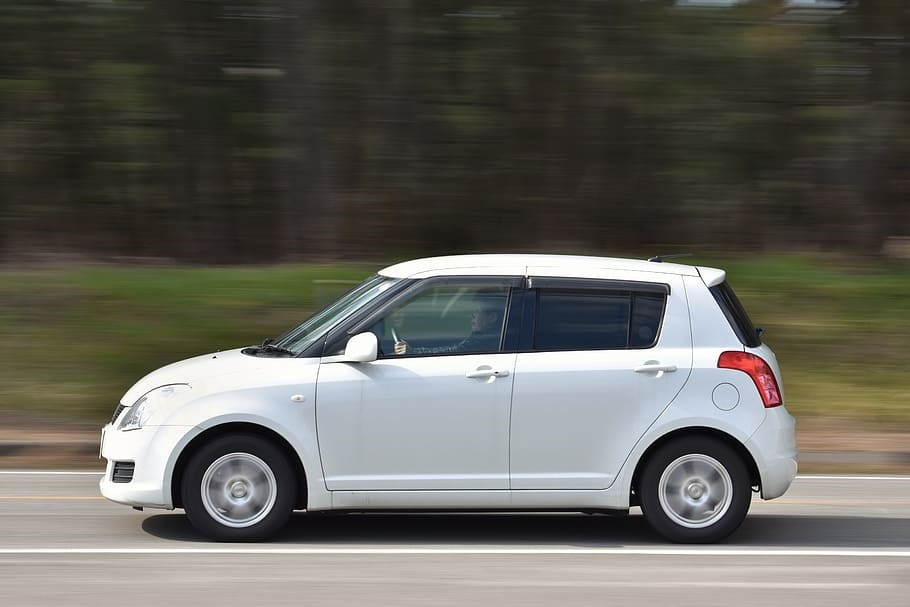 White suzuki swift car