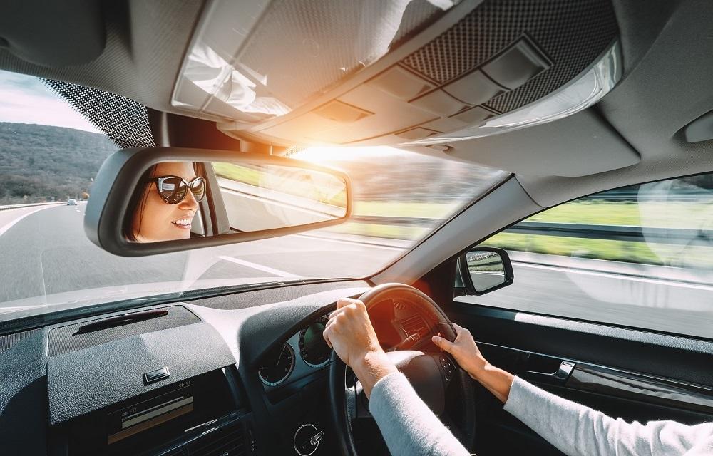 woman driving toyota yaris car