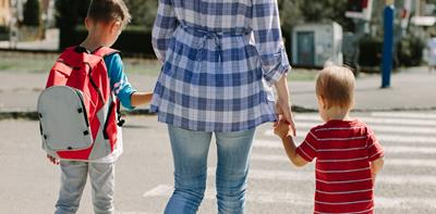 holding hands mum children crossing road