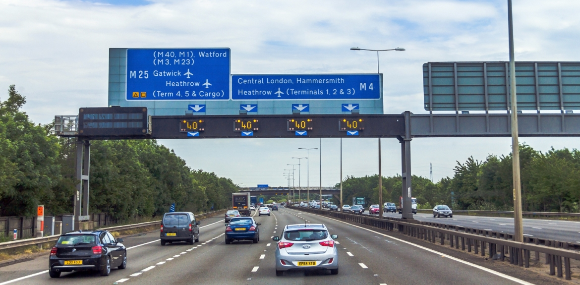 road signs above a motorway