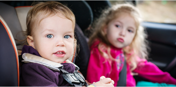toddler and young child sat in car seats