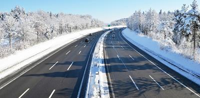 cars driving on motorway during winter