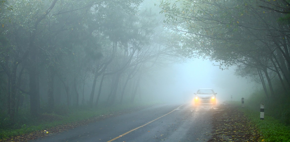 car driving with fog lights turned on