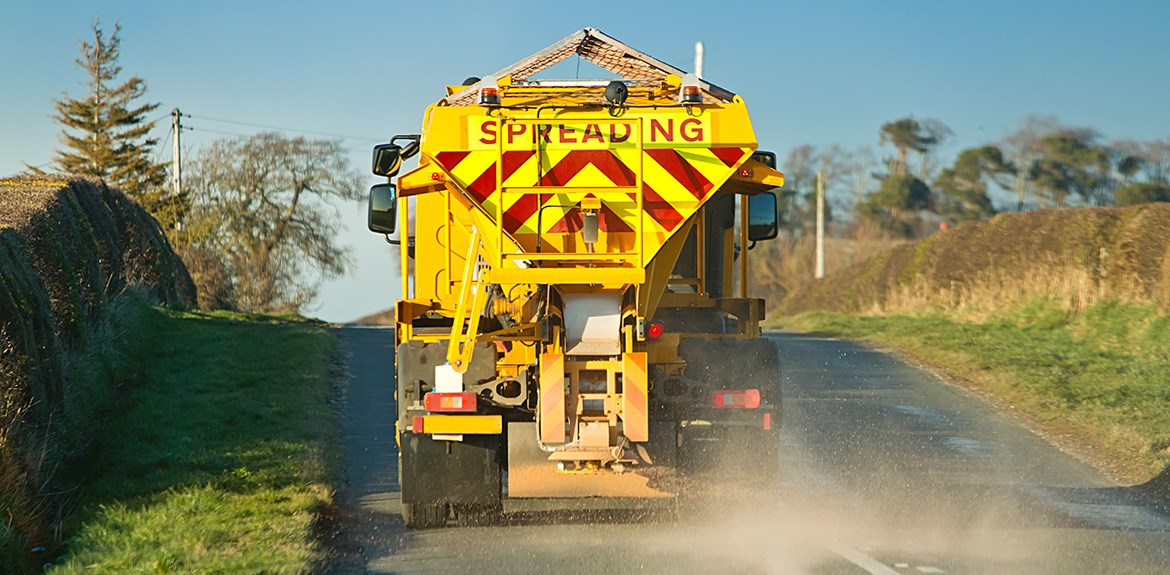 gritter spreading grit mixture on UK road
