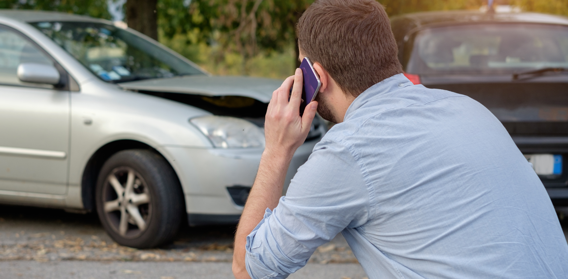 man phoning insurance company after an accident