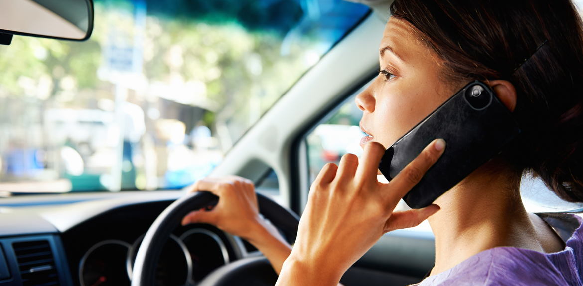 Woman talking on her mobile phone while driving