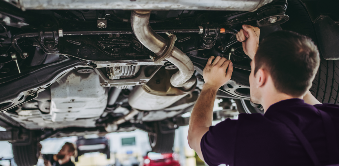 mechanic carrying out MOT test on a car
