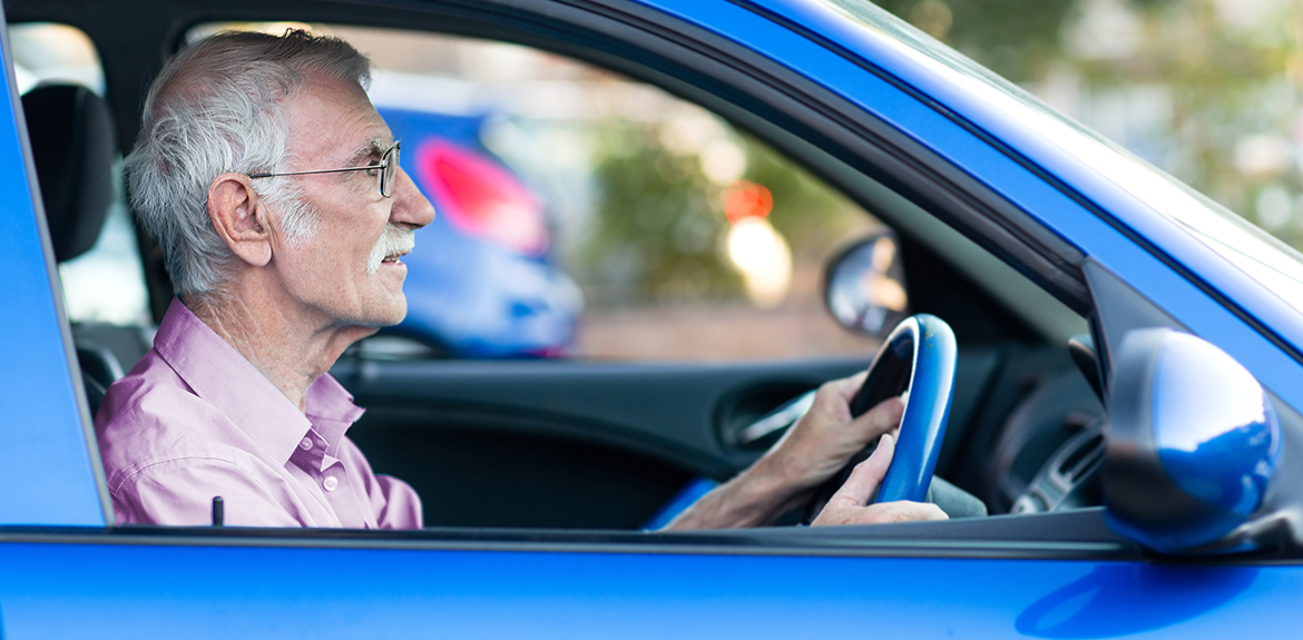 Elderly driver wearing glasses while driving