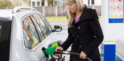 Woman putting fuel into her car