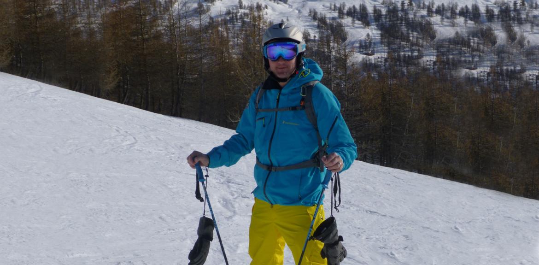 customer Richard in ski suit on slopes