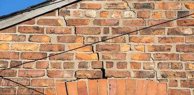outside wall with cracks due to subsidence