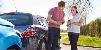 man and woman exchanging details after a collision