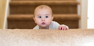 toddler climbing up stairs