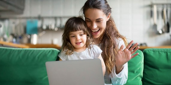woman child laptop home