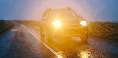 bright car headlights dark rain