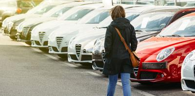 woman shopping to buy a used car