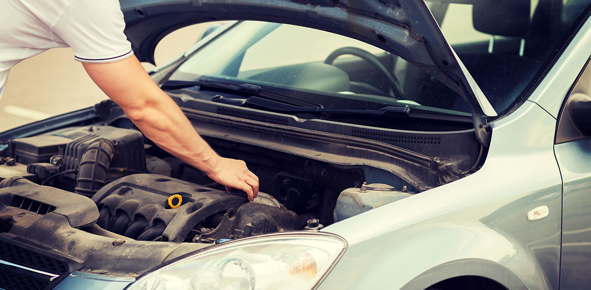 man checking car engine bonnet