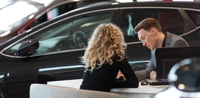 Man woman car dealership