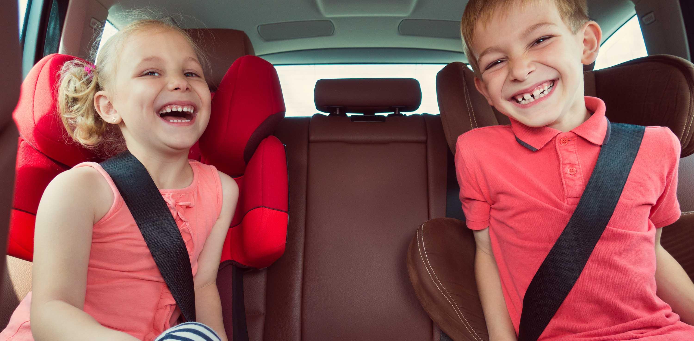 laughing boy girl in car seats