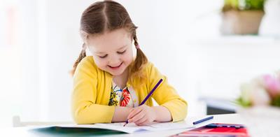 young girl colouring in colouring pages