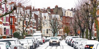 cars snowy terraced street driving parked