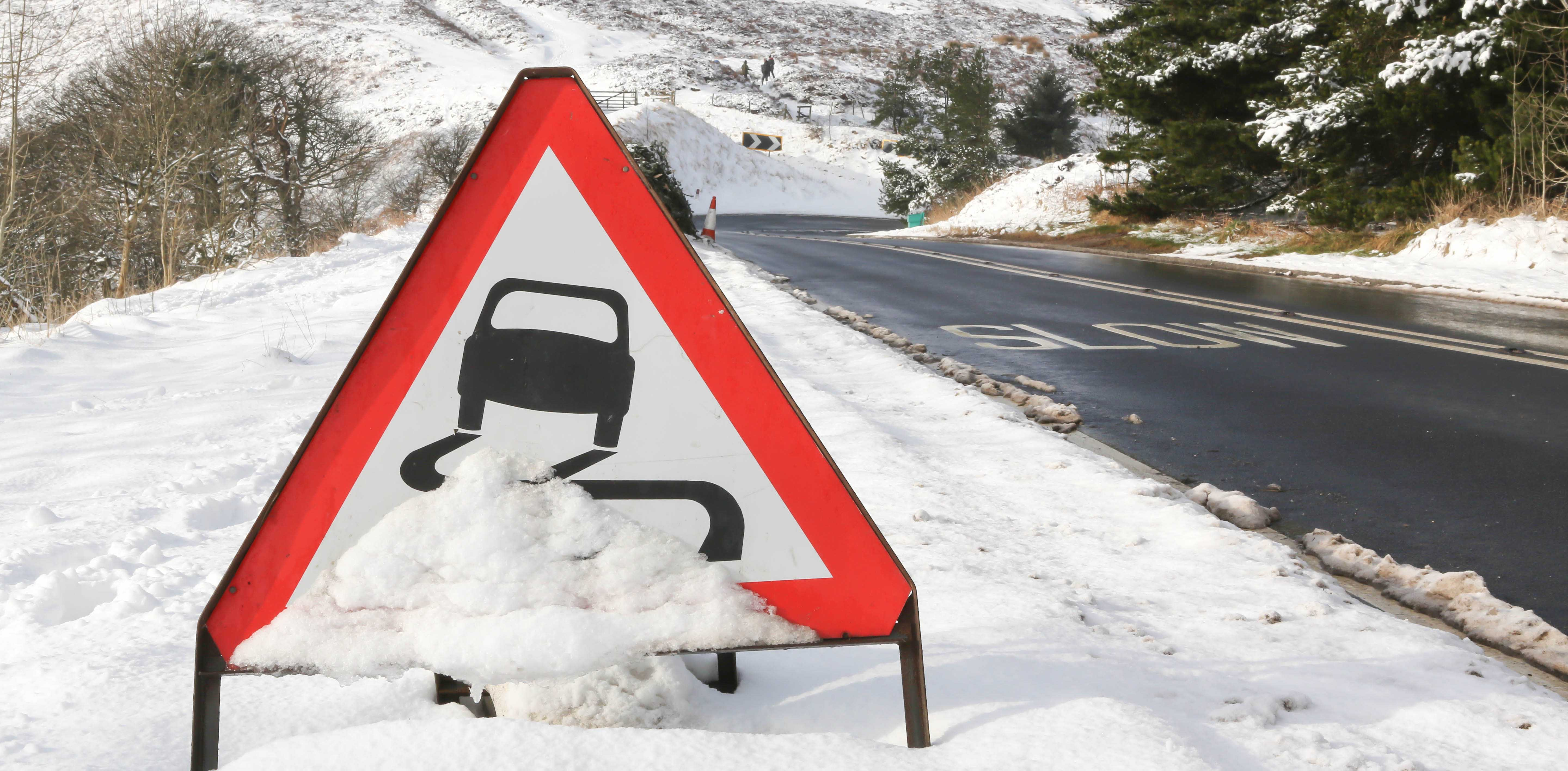 road sign snow winter