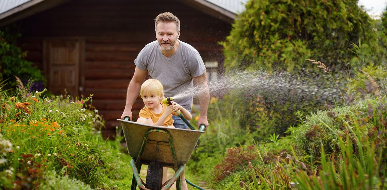man boy wheelbarrow garden