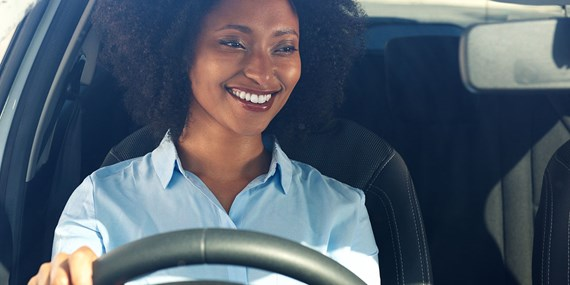 happy smiling woman driving
