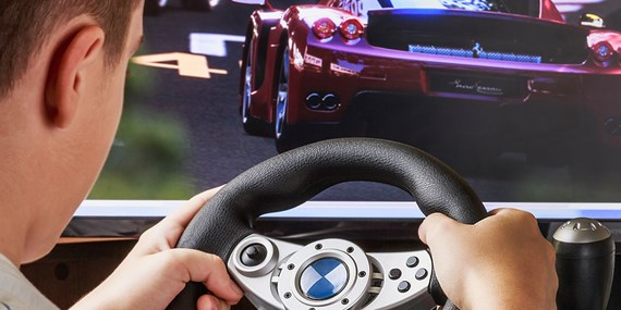 man playing driving racing car game
