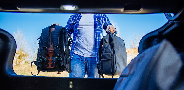 man loading bags car boot