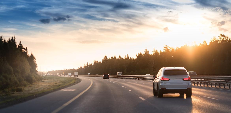 white car driving motorway