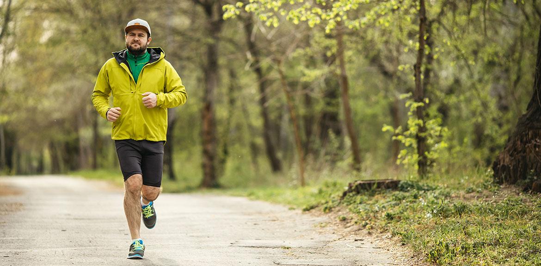 man running jogging yellow jacket shorts cap